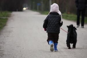child-walking-dog