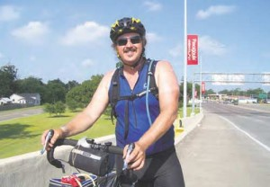 Hugh Holborn, who road his bike from St. Augustine, Fla., to Taos, is shown as he leaves Pascagoula, Miss.  Submitted photo